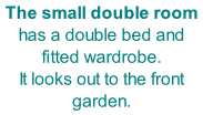 The small double room has a double bed and fitted wardrobe. It looks out to the front garden.