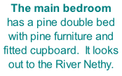 The main bedroom has a pine double bed with pine furniture and fitted cupboard.  It looks out to the River Nethy.